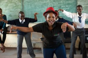 young1ove = Thato leading class in the interactive exercises to help get the kids involved by having fun.