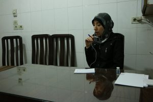 Al Ghouta, Syria - Dr Amani during interview in her office in the hospital. (National Geographic)